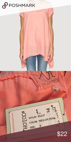 """Oversize Silk Like T-Shirt Pete and Greta The Pete & Greta SKYLER BLOUSE is Is bright with an oversized tee shirt, cut for a relaxed fit in flowy Cupra rayon, will fit seamlessly into your existing closet.  Bust 42"""" Length 30""""-36"""" - Melon Pink (Looks like Coral) - Scoop Neckline, Cap Sleeves with knit trim, Trapeze Hemline - Care Instructions: Machine Wash Cold, Tumble Dry Low Johnny Was Tops Blouses"""