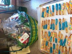 Cute idea for lollipop display easter pinterest easter gift bags for preschool easter party and white chocolate dipped pretzels thanks to the lady at target that suggested i use the honey wheat pretzels for negle Images