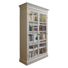"Display cabinet features crown moldings and adjustable shelving behind glass-paned doors. Dimensions: 86"" H x 53"" W x 17"" D"