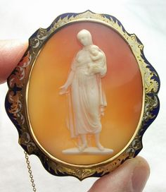 """The Charity""-Material: Cornelian Shell, 18k gold tested, enamel Size: 2 1/8"" by 1 7/8"" only cameo is 1 6/8"" by 1 1/2"" Date and Origin: Circa 1850/1860 Italy, frame could be English."