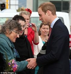 Making their day: Both William and Kate put a smile on the face of some of the families who lost loved ones in the 2011 quake