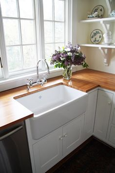 farmhouse sink and wooden countertop