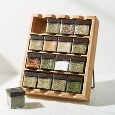 This striking spice rack sits props up with a collapsible iron stand for stove-side dispensing of herbs and spices, lying flat for convenient storage or for hanging on the wall. Glass Spice Jars, Glass Jars, Crate And Barrel, Spice Rack Organization, Kitchen Organization, Kitchen Storage, Spice Rack Storage, Wall Spice Rack, Spice Holder