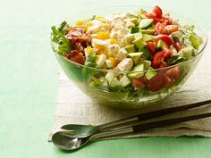 Try Food Network Kitchen's simple recipe for cobb salad success: thick-cut bacon, vine-ripened tomatoes, creamy avocado and crunchy lettuce are combined with a tangy dressing that's as bright as the summer sunshine.