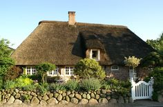 Thatched cottage On Being British England
