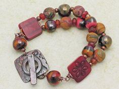 carnelian, red creek jasper, Kazuri beads, Tagua flower connector
