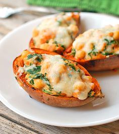 These healthy sweet potato skins are stuffed with mashed sweet potato, chickpeas, spinach, and Mozzarella cheese. So delicious!