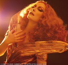 Swintons theatrical gold couture gown was created by London designer Antony Price