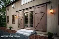 Image result for barn door in front of other door