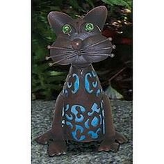 """11"""" Solar Powered Cat - Lights up Blue by Garden Oasis. $44.95. Lights Up Blue at Night. Solar Powered Cat. On/Off Switch. Cat Measures approximately 8"""" x 8"""" x 11 1/2"""". Includes 1 Rechargeable """"AA"""" Battery. Accent the outside of your home with these solar cats. Use these lanterns to illuminate the area around your home or garden!  How to turn the product on: Remove 3"""" solar unit in the metal case. Move switch to the on position. Place back into the solar lantern and twist to sec..."""