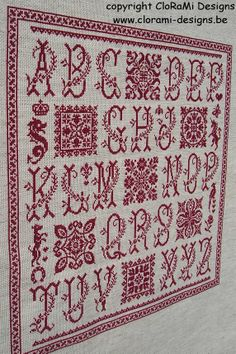 Red cross stitch sampler Cuadros from Clorami Designs. www.clorami-designs.be