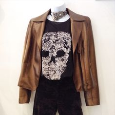 Alexander McQueen black cotton skull dyed T-shirt with Akris copper riders jacket. Both size S. The beautiful hand work black pearl choker adds more accent on this coordinate.   Please call (949) 715-0004 for all inquiries.  #couture #designer #runway #consignment #luxuryconsignment #lagunabeach #fashion #style #luxury #stylish #luxuryshopping #shoes #heels #outfit #purse #jewelry #shopping #glam #readytowear #lambskin #akris #alexandermcqueen #OC #orangecounty #LA #losangeles #madeinItaly