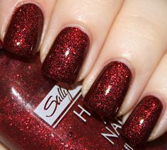 Sally Hansen Ruby Slippers over Wet n Wild Blackest Red. (I think both of these nail polishes are discontinued, but I think Sally Hansen's Red Carpet or China Glaze's Ruby Pumps over any dark red polish would look similar to this. Isn't it so pretty?)