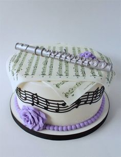 Music themed cake. Fondant Flute. Music notes cake. Sheet music Cake.