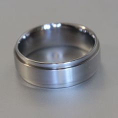 Titanium ring with raised centre