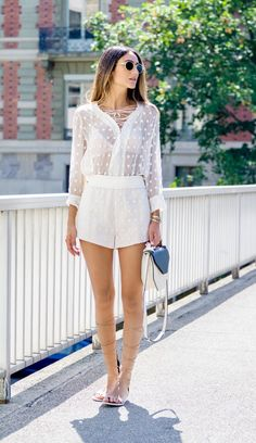 How to Wear High Gladiator Sandals thisSummer   Street Style Outfit Inspiration   'Soraya Bakhtiar' in all-white ensemble and minimal knee-high gladiator flats