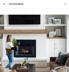 Best fireplace - not short and long. Good hearth. Blends in but useful. Like the white brick. Good mantle. Clean lines.