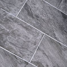30x60cm Indus dark grey GS-N7012Indus dark grey GS-N7012 is a matt finish glazed porcelain tile.  30x60cm stone effect floor tile made by the Turkish manufacture kalebodur.  Matt finish makes Indus dark grey perfect as a floor tile anywhere in the home. Hallways, conservatory floors, kitchen floor or splash-back along the wall. The big size makes tiling a bathroom wall simple and easy. Very durable with easy maintenance. Does not require sealing.