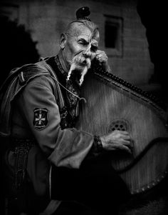 A Kobzar (Ukrainian: кобзар) was an itinerant bard who sang to his own accompaniment. Kobzar literally means 'kobza player', a Ukrainian stringed instrument of the lute family, and more broadly — a performer of the musical material associated with the kobzar tradition. The institution of the kobzardom essentially ended in the mid 1930s during Stalin's radical transformation of rural society which included the liquidation of the kobzars of Ukraine.