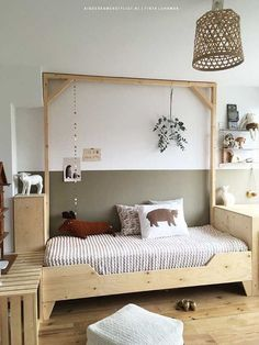 Gorgeous colours in a kids room + wooden kids bed