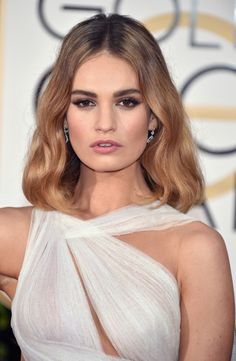 Lily James: http://www.stylemepretty.com/2016/01/11/best-beauty-golden-globes-2016/