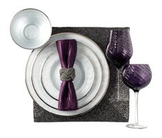 Use rich eggplant, metallic silver and sparkly charcoal for a smoky and sophisticated place setting.