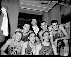 """Members of UNC's 1957 national championship team: """"Still undefeated after a triple-overtime win over Michigan State in the semifinals, the Tar Heels upset Wilt Chamberlain and Kansas, again in triple-overtime, even after Rosenbluth fouled out late in regulation. Despite the Jayhawks' home-court advantage, it was quiet at the start and quiet at the finish, after Joe Quigg hit two free throws to seal the 54-53 win."""""""