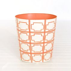 "Worlds Away Oval Wastebasket Cream and Orange    << Previous in Wastebasket and Tissue Holders	Next in Wastebasket and Tissue Holders >>        : $135.00  Item Number: WB-SQUAREDOR  Manufacturer: Worlds Away  Quantity:  Add to a new shopping list    Email this page to a friend    Oval wastebasket cream and orange    Dimensions: 12"" h x 11"" d x 9.5"" w"