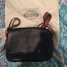Fossil crossbody Black crossbody with brown strap. Fossil Bags Crossbody Bags