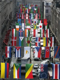 Olympic flags of 156 nations go up in London's Regent Street. .