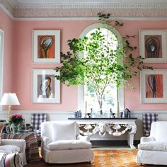 """It takes courage to combine pink walls with eighteenth- century plasterwork, an orange patterned rug, textiles that call to mind Liquorice Allsorts and Georgian reproduction furniture. But it certainly works in this magnificent house. The paintings are by [link url=""""http://nandahobbs.com/artist/robert-doble""""]Robert Doble.[/link]   Like this? Then you'll love  [link url=""""http://www.houseandgarden.co.uk/interiors/pink-rooms""""]30 Pink Rooms[/link]"""
