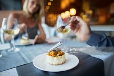 Stock-Foto : Couple eating dessert in fancy restaurant
