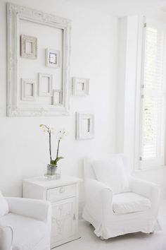 A few intentionally placed empty frames adds texture, dimension and visual interest to otherwise empty spaces. Try painting them in a similar hue for a more uniform look. White Rooms, White Walls, White Bedroom, Interior Exterior, Interior Design, Interior Paint, Empty Frames, White Cottage, Cottage Style