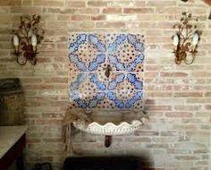 Lavabo esterno decorato con maioliche siciliane tiles pebbles