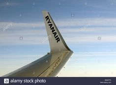 Download this stock image: Aircraft winglet carrying the name Ryanair a low cost European airline and open skies backdrop seen from the cabin of a Boeing - BMAPTD from Alamy's library of millions of high resolution stock photos, illustrations and vectors.