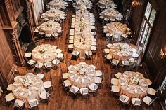 large central oval head table surrounded by rounds. High yield for space while still having a head table where people can talk to each other. | Photography by volatilephoto.com, Floral Design by vandafloral.com