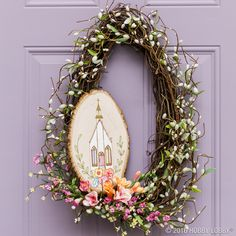 This simply sweet statement piece is perfect for Easter! 1) Freehand or trace a church design on a wood plaque. 2) Burn the design into the wood using a woodburning tool. TIP: Try practicing on a piece of scrap wood first, starting on a cooler setting. 3) Add details with acrylic paint. Let dry. 4) Wrap garland around a grapevine wreath. 5) Attach the plaque with screw eyelets and floral wire, and finish with flowers.