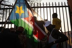Geography of Sudan: Voters celebrate with the flag of south Sudan during the first day of voting for the independence referendum in the southern Sudanese city of Juba January 9, 2011 in Juba, Sudan.  The result is expected to split Africa's largest country in two.