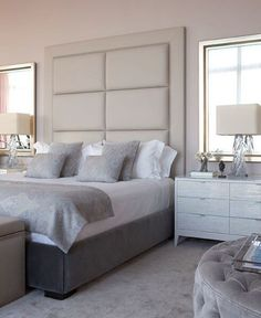 Symmetry - large mirrors on either side of bed at a similar height to headboard