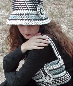 A hat and purse made from pop can tabs and old strips of t-shirt.  Adorable.