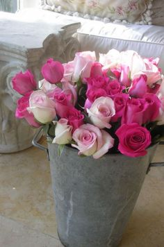 """a galvanized flower pail takes the """"stuffy"""" out of florist's roses"""