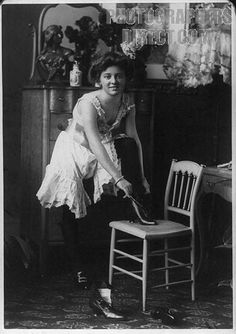 Young woman ( prostitute) shown as she dresses 1900s image stock photo