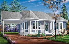 This house plan has a porch that wraps from the front to the carport on the side. The bay window that can be seen from the front is part of a magnificent master bedroom. The kitchen features an island with an eating bar on the outside. data-pin-do= Best House Plans, Country House Plans, Small House Plans, Country Farm, Victorian House Plans, Victorian Homes, Bungalow House Plans, House Floor Plans, What House