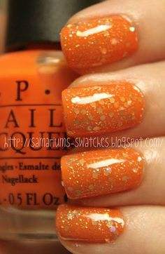 Orange Glitter Nails -- Normally not a fan of orange, but this looks sparkly and fun!