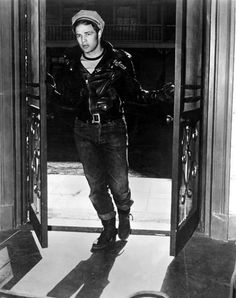 Marlon Brando made the T shirt, leather jacket and jeans a male fashion staple as relevant today as in the 50's. This is from The Wild one released in 1953
