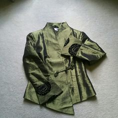 Silk Jacket Silk jacket with black velvet appliques. Handmade for me in China but the size is cut very  small. Says XL but fits more like Med. It's very Beautiful!! Tops