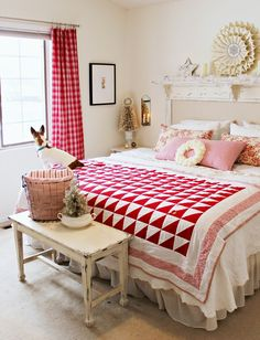 great red quilt helps accent the vintage rust on this old iron bed