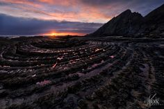 Dark Land by Enrico Fossati on 500px The low tide reveal a surreal and beautiful world of twisted roks