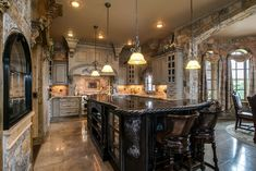 Kitchen with flush light, High ceiling, Undermount sink, Complex granite counters, Breakfast nook, Pendant light