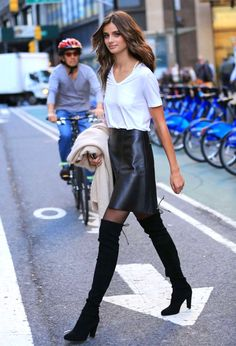 Taylor Marie Hill // wavy long hair, white pocket tee, leather skirt, tights and over-the-knee boots #style #fashion #model